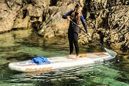 Stand Up Paddle Boarder taking part in private 1-to-1 SUP lessons and tours in Newquay with SSS Surf School